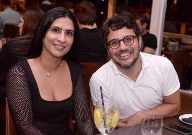 Carine Queiroz e Fausto Franco jantando no Soho em fotos de Valterio
